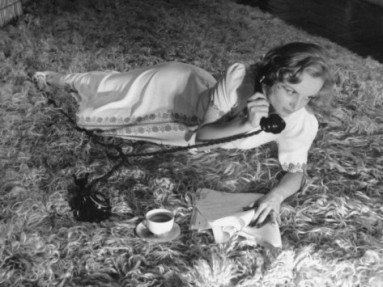 Reference:  http://imgc.allpostersimages.com/images/P-473-488-90/27/2759/3E4TD00Z/posters/alfred-eisenstaedt-actress-carol-lombard-talking-on-telephone-as-lies-on-rug-with-cup-of-coffee-at-home.jpg